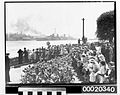 Crowds awaiting HMAS SYDNEY (II) after returning from service in the Mediterranean, near Admiralty House (Kirribilli) prior to mooring at Circular Quay, February 10th 1941 (3294194400).jpg