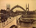 Crowds crossing the Pont de l'Alma, Paris Exposition, 1889.jpg
