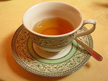 An orange tea in a teacup