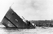 Naval ship struck by a mine and sinking