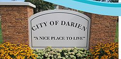 "Monument sign advertising the Darien as a ""nice place to live."""