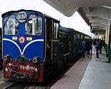 Blue diesel train at a station