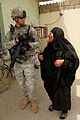 Defense.gov News Photo 100523-A-7879C-137 - U.S. Army Staff Sgt. Samuel Ward attached to the 17th Fires Brigade s Guardians Maneuver Element speaks to an Iraqi woman at a bus and taxi.jpg