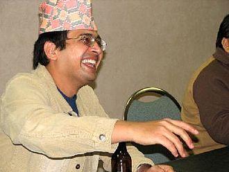 Dhaka topi - Dhaka topi worn by a laughing man