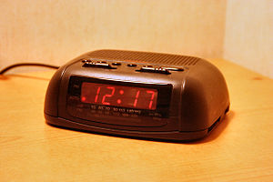 LED digital clock radio with analog AM/FM radi...
