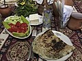 Dinner at the home of a Goris bread maker (28255050556).jpg