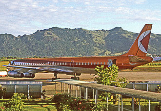 Nadi International Airport - Nadi Airport in 1971 showing the open-sided covered walkways between the aircraft and terminal. A Canadian Pacific Air Lines DC-8 is pictured.