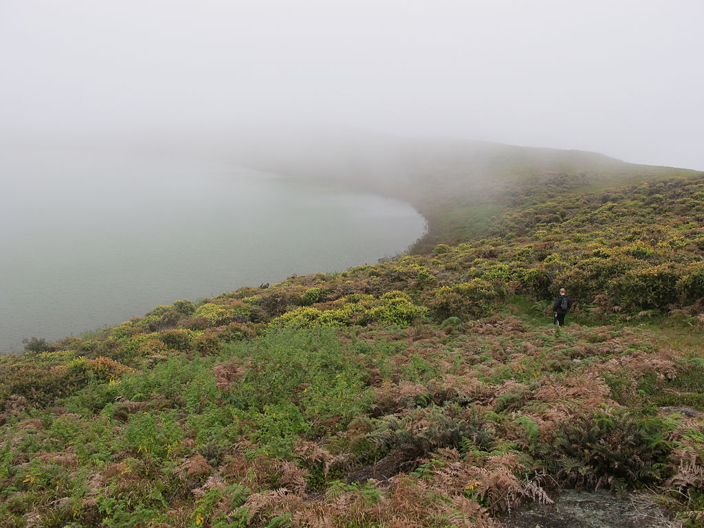 A person hiking around El Junco crater lake, Galapagos