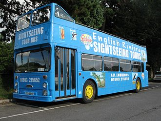 "Torbay - An open top bus advertising the ""English Riviera"""