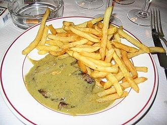 """Café de Paris sauce - An """"entrecôte Café de Paris"""", as served in Le Relais de Venise, the first French """"entrecôte restaurant"""" in Paris. In spite of its name, the Café de Paris sauce was born  in Switzerland."""