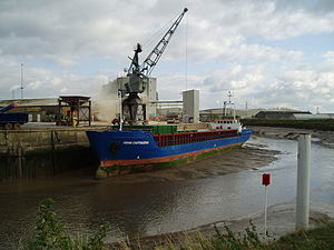 """The Haven, Boston - The """"Fehn Cartagena"""" unloading a cargo of stone while moored on a mudbank in The Haven, opposite the Black Sluice"""