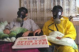 Civil defense in Israel - An Israeli family in its sealed room, with gas masks, during the 1991 Gulf War