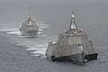 Flickr - Official U.S. Navy Imagery - The first of class littoral combat ships USS Freedom and USS Independence maneuver together during an exercise off the coast of Southern California..jpg