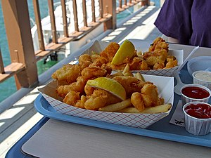 Fish fry - American style fish and chips  with lemon, ketchup, cocktail sauce, and tartar sauce as served in San Diego.