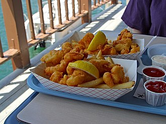 Fried fish - Fried fish and chips with lemon, ketchup, and tartar sauce as served in San Diego.
