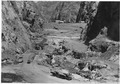 General view looking upstream of foundation excavation. Deeper middle channel is shown prior to any disturbance by... - NARA - 293839.tif