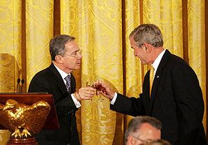 George Bush toast with Alvaro Uribe Velez