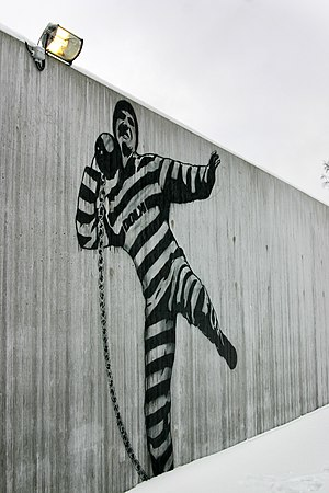 Halden Prison - A wall in the courtyard graffitied by Dolk