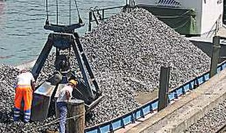 Rock mechanics - Gravel being unloaded from a barge
