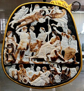 History of the Roman Empire - The Great Cameo of France, a cameo five layers sardonyx, Rome, c. 23 AD, depicting the emperor Tiberius seated with his mother Livia and in front of his designated heir Germanicus, with the latter's wife Agrippina the Elder; above them float the deceased members of their house: Augustus, Drusus Julius Caesar, and Nero Claudius Drusus