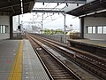 Hanshin Line - Dekijima station - platform (east) towards the south.jpg