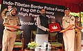 Hansraj Gangaram Ahir being presented a memento by the DG, Indo-Tibetan Border Police (ITBP), Shri Krishna Chaudhary, at the flag-off ceremony of the High Power SUVs procured by the ITBP for its BOPs, in New Delhi.jpg