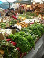 Haymarket Boston merchant arranging produce.JPG
