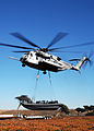 Helicopter Lifts a Rigid Hull Inflatable Boat DVIDS82319.jpg