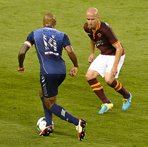 Michael Bradley (soccer) - Thierry Henry takes on Michael Bradley of A.S. Roma at Sporting Park.