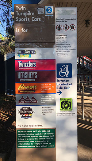 Hersheypark - This is a height measurement board at the entrance of the Twin Turnpike Sports Cars ride in Hersheypark.