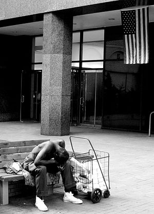 A homeless man in New York with the American f...