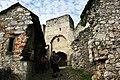Hrad Rabí s hradním kostelem Nejsvětější Trojice, část stojící, část zřícenina a archeologické stopy (Rabí).jpg