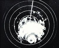 Black and white radar image of a hurricane. Rainbands are visible, as well as the eye, on radar.