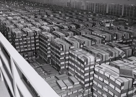 Punched cards in storage at a U.S. Federal records center in 1959. All the data visible here could fit on a single flash drive. IBM card storage.NARA.jpg