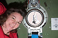 ISS-27 STS-134 Cady Coleman next to a porthole with the Endeavour.jpg