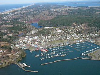 Ilwaco, Washington - Aerial view of Ilwaco and Ilwaco Harbor; the western edge of Long Beach Peninsula is on the left, and cranberry bogs are visible immediately north of downtown Ilwaco