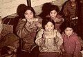 Inuit women and children soften sealskin by chewing it, Nunavut Des femmes et des enfants inuits mâchent des peaux de phoque pour les assouplir, au Nunavut (31497044186).jpg