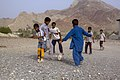 Iranian Baluchi children playing beach soccer. South kerman 01.jpg
