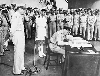Royal New Zealand Navy - Air Vice Marshal Leonard M. Isitt, representing New Zealand, signs the Japanese Instrument of Surrender on-board USS ''Missouri'' under the gaze of the Supreme Allied Commander Douglas MacArthur (left)