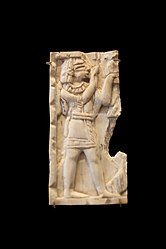 Plaque: Egyptian-style man with raised hands