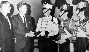Boston Crusaders Drum and Bugle Corps - Drum majors of the Boston Crusaders make President John F. Kennedy an honorary member of their corps in 1963
