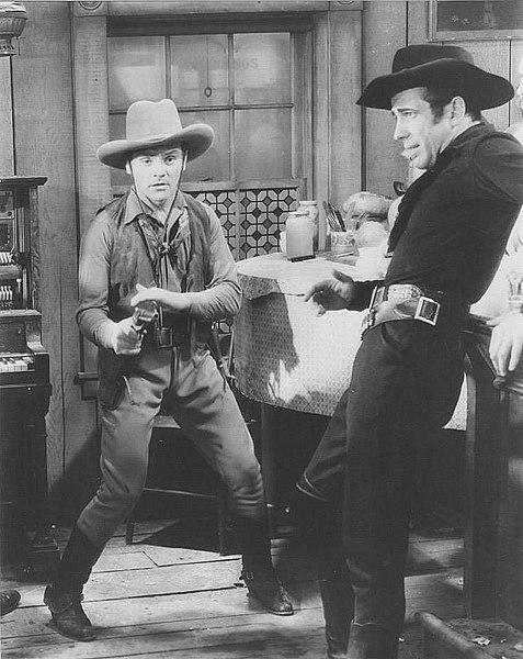 477px-James_Cagney_Humphrey_Bogart_Oklahoma_Kid_Still.jpg