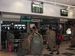 Jerusalem Central Bus Station - Israeli soldiers wait to board intercity buses at an indoor platform on the third floor.