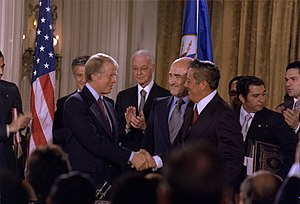 History of Panama (1977–present) - Jimmy Carter and Omar Torrijos shake hands moments after the signing of the Torrijos-Carter Treaties.