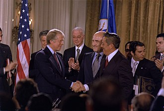 Torrijos–Carter Treaties - Jimmy Carter and Omar Torrijos shake hands moments after the signing of the Torrijos–Carter Treaties.