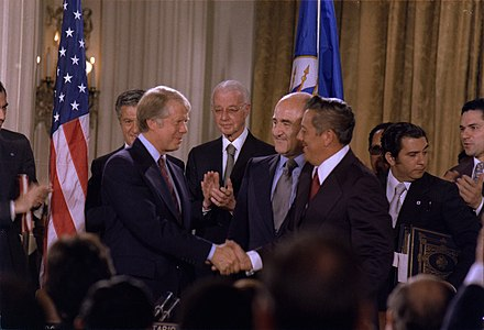 US President Jimmy Carter shakes hands with General Omar Torrijos after signing the Panama Canal Treaties (September 7, 1977). Jimmy Carter and General Omar Torrijos signing the Panama Canal Treaty.jpg