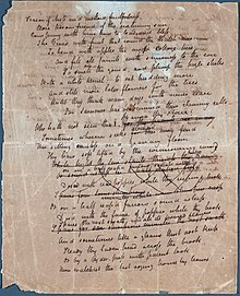 A white sheet of paper that is completely filled with a poem in cursive hand writing. Many of the lines mid-way down the page are scratched out.
