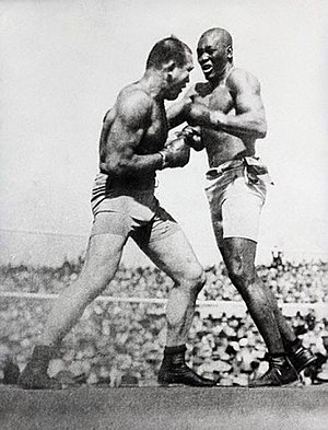 Fireman Jim Flynn - Jack Johnson boxing on right with Jim Jeffries