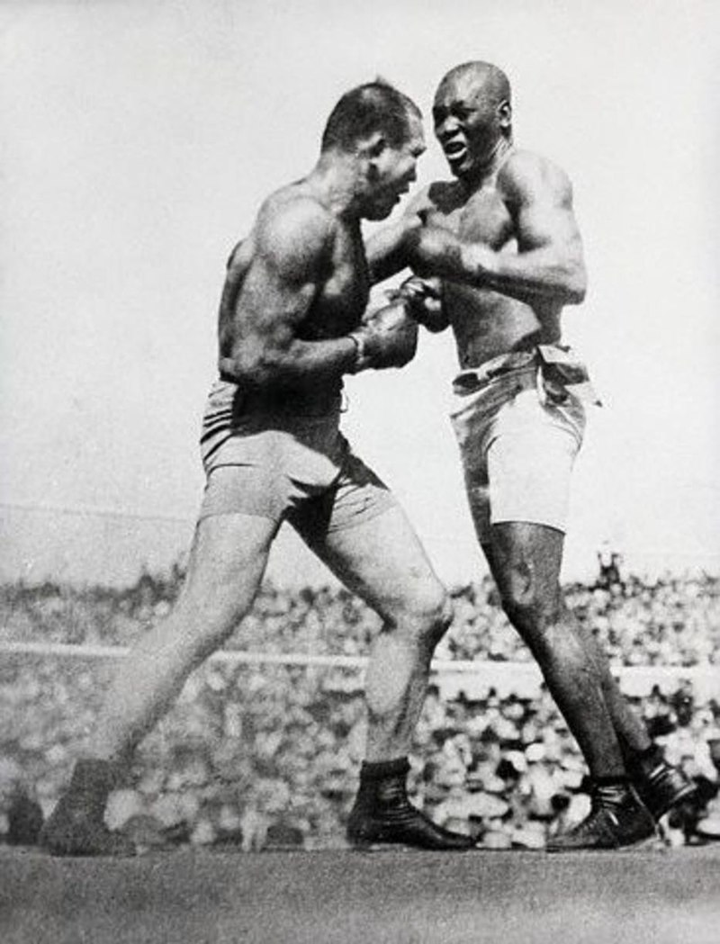 July 4, 1910: Black challenger Jack Johnson defeats White world heavyweight boxing champion James J. Jeffries in 15th round at Reno