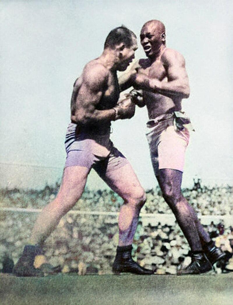 July 4, 1910: Black challenger Jack Johnson defeats White world heavyweight boxing champion James J. Jeffries in 15th round at Reno